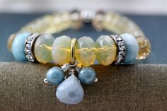 Baby blue,Boho, hippie, stretch stack bracelet, blues and creams    This bracelet fits comfortably up to a 6 1/4 wrist. I can re-size for you,