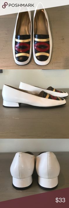 """Vintage Magdesians Block Heel Shoes The front design on these shoes is so striking! Vintage California Magdesians with a low block heel. Ivory leather with navy, red, and gold leather accents across the top of the shoe. In very good vintage condition!  A few minor scuffs and imperfections to the leather but nothing of great concern. The right heel cap has some wear to it. Please reference photos for flaws. Labeled as a size 10N but could work for a 9.5M. Heel measures 1.25"""", width across the…"""