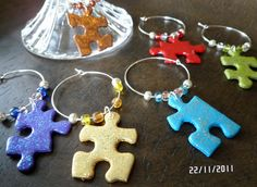 Upcycled Puzzle Piece Wine Charms on Etsy. Puzzle Piece Crafts, Puzzle Art, Puzzle Pieces, Wine Craft, Wine Bottle Crafts, Cork Crafts, Fun Crafts, Autism Crafts, Wine Glass Markers