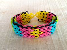 Rainbow Loom bracelet made from yellow, ocean blue. neon green, and pink. ArtyCraftySudio on Etsy