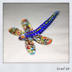 Fused glass slumped dragonfly, made from scrap.
