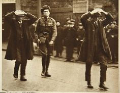 Two Sinn Fein members being arrested by British troops during a raid on the Ministry of Labour offices in Dublin, 1920
