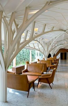 """Chris lee and Kapil Gupta serie architects have completed the design of a banquet hall in Mumbai , India. They converted a disused building from Mumbais colonial past into a new banquet hal with a restaurant and bar called """"The tote"""" . The design was inspired by avenue of trees in the site ."""