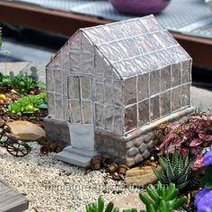 Only very serious miniature gardeners have a Greenhouse in the backyard of their cottage. The mini hothouse is made of resin, but is designed to look like a typical greenhouse with a clear roof and walls to capture the warm of sunshine to provide heat. Winter Greenhouse, Backyard Greenhouse, Homemade Greenhouse, Greenhouse Plants, Small Greenhouse, Greenhouse Ideas, Modern Greenhouses, Ideas Dormitorios, Fairy Village