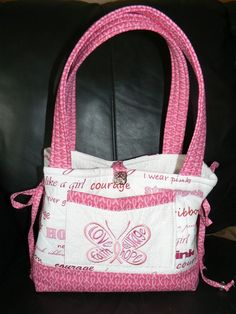 """Fight Like a Girl"" handbag for Breast Cancer Awareness"