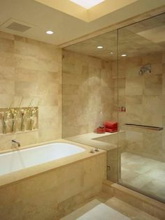 Master bath ideas-love that the bench is the same height as the tub...visually continues the line and keeps it cleaner looking