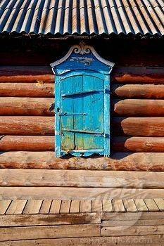 Log home, Russia. Colour is such a treasure during the endless monochromatic winter.
