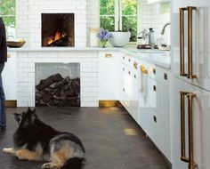 love the raised fireplace and log storage beneath. Not crazy about the white brick...stone perhaps...