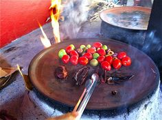 Dry roasting tomatoes and chiles on the comal, learn this and other traditional Mexican cooking techniques in the book Celebraciones Mexicanas: History, Traditions and Recipes available now to pre-order at http://www.amazon.com/Celebraciones-Mexicanas-Traditions-AltaMira-Gastronomy/dp/0759122814