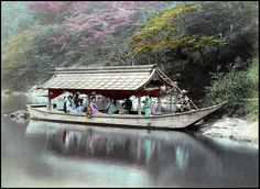 "Called a ""Houseboat"" in the original caption from 1897, it looks like one of the pleasure boats used for trips down the Hozu River near Arashiyama, Kyoto. Being filled with what looks like MAIKO and GEISHA (called GEIKO in Kyoto), it probably doubles as a Yakatabune --- a ""party boat"" or ""dinner cruise boat"". They are still doing it today...with the same style boats !"