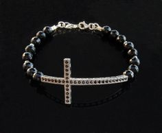 Love this lady's work: Sterling silver cross bracelet with black onyx and black ruby stones