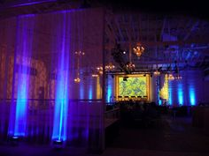 Setting: Industrial Warehouse Wedding Inspiration, great lighting ideas with these uplit sheer drape divider.