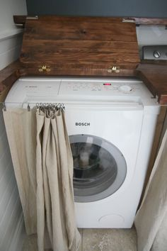 hinged top on washer/dryer for easy access to top loading appliances...brilliant idea!