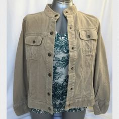 """Tommy Hilfiger corduroy jacket Tommy Hilfiger Corduroy jacket   •Chinese-style collar •Tan color •2 front breast pockets •Measurements: armpit to armpit = 21"""", sleeve = 24"""", shoulder to hem = 22 1/2"""" •Worn a few times = in excellent condition •🚫Trades •🚫Paypal •All reasonable offers will be considered 😊 •Bundle and save 💰 Tommy Hilfiger Jackets & Coats"""