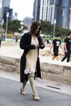 Leave it to Kanye West's muse, Christine Centenera, to take a sleepy-time slip dress ouside the bedroom with an oversized cardigan and thigh-high boots. #refinery29 http://www.refinery29.com/2016/05/111596/sydney-fashion-week-resort-2016-street-style-pictures#slide-6