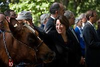 Sept. 15, 2009: Sen. Amy Klobuchar, D-Minn., pets Maple Lawn Maggie during a news conference in Upper Senate Park on legislation to help dairy farmers.