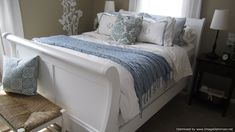 Sleigh bed that was painted white and stencil wall.