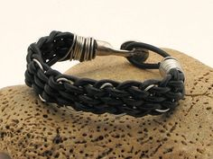 FREE  SHIPPING.Unisex leather bracelet. Black leather and wire  braided bracelet with silver plated clasp .  for men or women