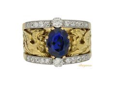 Art Nouveau natural sapphire and diamond carved ring. . Renaissance Fine Jewelry adores this beautiful jewel! For fine antique jewelry visit us at 151 Main St. Brattleboro, Vermont.