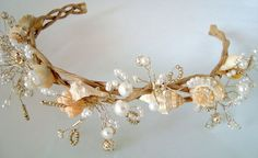 I love this new design. It is so delicate & romantic looking. I filled the seashells with bursts of pearls & silver beads. They float out of the shells on silver hand twisted wire. Look like a Goddess whether on the beach or on land. The wreath-headband is of natural looking twisted covered wire. This headpiece can be worn as a headband or a wreath. Hair pins included. I can add ribbons for tying at no addl cost.    Headpiece is approx. 14 inches around. It is 2 inches wide. Beaded area is…