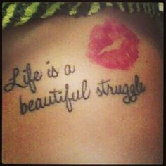 Side tattoo right below my left boob. My cousin and I got each others lips tattooed onto each other but the quote was something I only got.