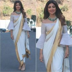 White saree with golden edges with off shoulder blosue