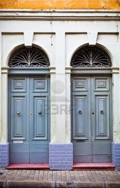 Beautiful town house doorways in Sliema, Malta. Sliema is a town in the Central Region of Malta. It is a center for shopping, restaurants and café life. Tas-Sliema is also a major commercial and residential area and houses several quality hotels.