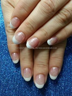 White acrylic tips with pink glitter gel polish