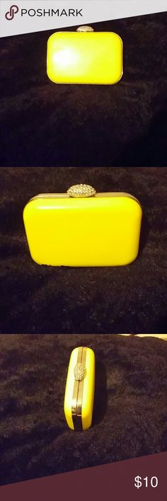 Neon clutch This neon yellow clutch is a great statement piece. Pair it with a black dress or something with a hint of neon yellow. Bags Clutches & Wristlets