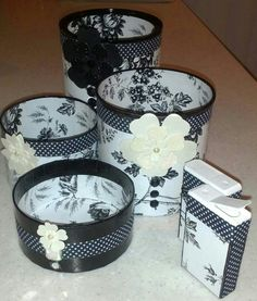Awesome set of hard cardboard canisters, along with tic tac box decorated with pattern mylar, decorative flowers and sticky ribbon. So cool, they can be used to store, medications, bobby pins, safety pins, tacks, nails, small rubber bands, hair ties. So many items can be stored in these handy storage containers.