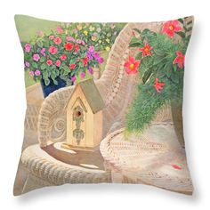 """A fresh design for springtime decor!  Click the image to buy this new toss pillow on Fine Art America.  Nancy Lee Moran painted the art of """"Summer Joy,"""" in which bright flowers abound, while a birdhouse is ready to be hung. See more birdhouse art on Nancy Lee Moran's blog page. ♡ http://nancyleemoran.com/blog/?p=944 ♡ #garden #sunny #summer #porch #wicker #chair #flowerpot #birdhouse #impatiens #violas #mandevilla #oilpainting #pillow"""