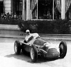 Juan Manuel Fangio driving his Alfa Romeo to victory in the 1950 Monaco Grand Prix.