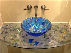 Interesting...hadn't thought of creating a fused glass countertop.  dichroic glass & sharp design