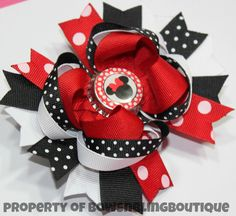 "I love this super cute minnie mouse inspired hair bow! The bow is layered with vibrant colors and beautiful ribbon. Each bow pictured measures approximately 4.5""- 5"" across. It is perfect for babies,"