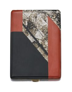 Lacquer Cigarette Case, Jean Dunand, 1920s Rectangular, decorated with an interlocking geometric motif composed of orange and black lacquer inlaid with varying shades of cream to grey eggshell.