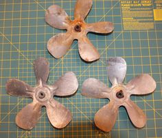 These old fan blades are surplus possibly from the Korean War. A bit rusty and even a bit rough on the surface, these blades measure about 8 inches in