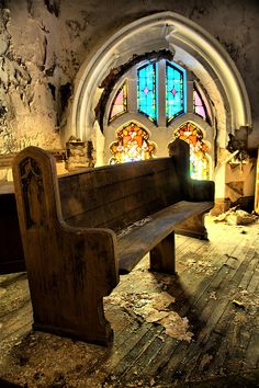 Timber pew in decaying church