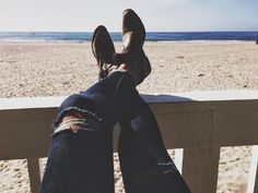 ripped black skinny jeans, western cowboy ankle boots