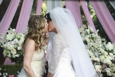 Arizona and Callie, Grey's Anatomy: Not only do Callie and Arizona tie the knot, but they celebrate it with a very sweet kiss.  Photo copyright 2011 ABC, Inc.