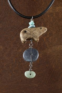 Luann Udell;  My handmade artifacts: bear and stones, with sterling silver and leather cord.