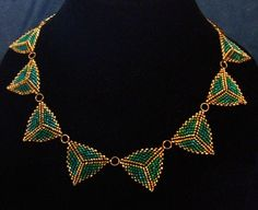 Peyote triangles using teal and gold size 10 seed beads.    www.facebook.com/teristreasures