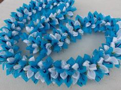 Turquoise frost tears ribbon lei by AlohaRibbonCrafts on Etsy