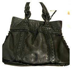 Black leather handbag All leather handbag, scalloped edge lacy details,  woven leather, braided leather handles,  soft supple leather, magnetic closure. One zippered pocket, two slip pockets, great quality! Elliott Lucca Bags Satchels