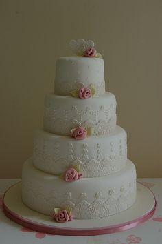 Fondant lace wedding cake with ribbon roses