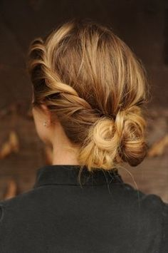 All you have to do is create a side part and take the front section of hair on the right side and twist upward. After that just secure at the back of the head, and then put hair up into a bun.