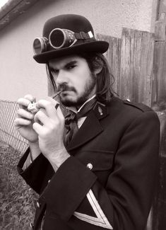 Young Steampunk men  with a pipe