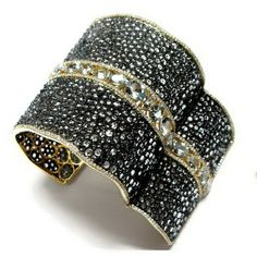 Etho-Lithos Jewelry 18k gold bangle with 77.91 cts. t.w. black topaz, 23.86 cts. t.w. aquamarines, and 4.55 cts. t.w. diamonds; $14,400. #EthoLithos #gold #blacktopaz #aquamarine #diamond