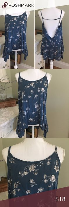 "Don't Ask Why Blue Floral High Lo Backless Top This slightly sheer blue and white flower top from Don't Ask Why is backless and features spaghetti straps. Made in Italy. Size: One Size. Chest: 20"". Length (front): 25"". Length (back): 29"". Don't Ask Why Tops Tank Tops"