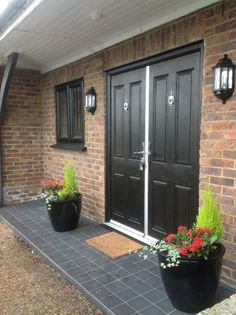 Style and Safety with Composite Doors - black on the outside, wood foil finish