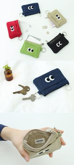 The SOM SOM Card Pouch is a cute and colorful card pouch to carry all your cards in! Store your cards, bills, coins, ID and other small items to conveniently carry it with you at all times. The key ring can also hold your keys or lets you attach a neck strap on it.